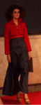 Red military cropped jacket with Harlem denim trousers by Amelie Goillott