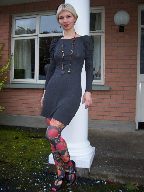 Grey puff long sleeve dress with shoulder pads paired with floral tights and gipsy necklace