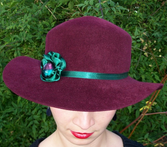 Maroon wide brimmed hat with green beaded flower detail