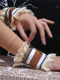 Chanel Style cuffs made from the cuff of a man's shirt and embellished with cotton lace and vintage gold metallic trimming. Available on Etsy $44