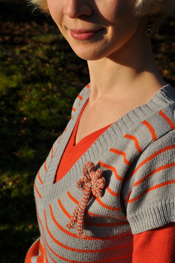 orange and grey stripy jumper