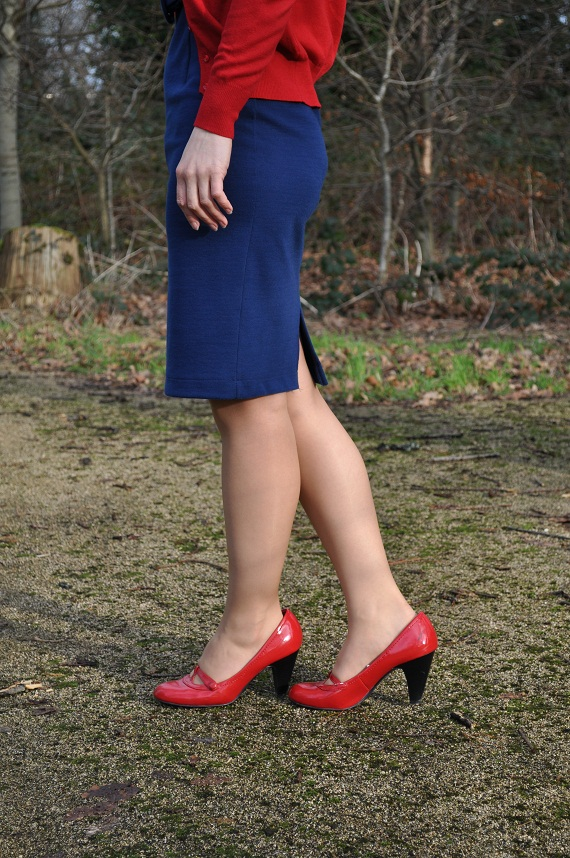 navy pencil dress with red shoes