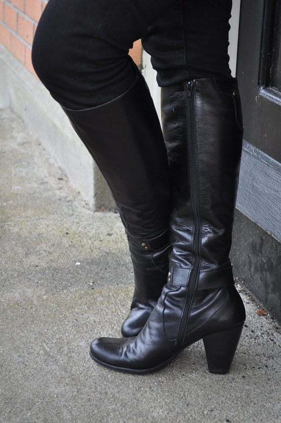 knee-high black leather boots