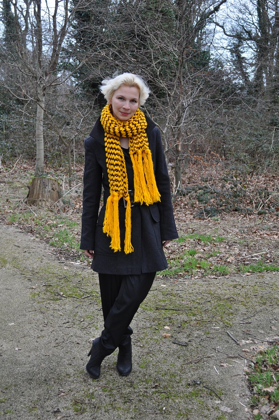 black slouchy harem pants with yellow chunky knitted scarf and grey military style coat