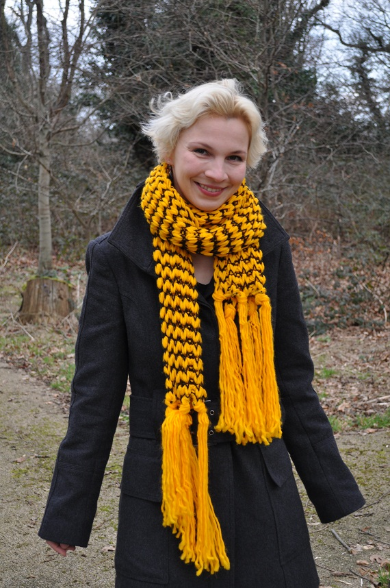 grey military coat with yellow chunky knitted scarf