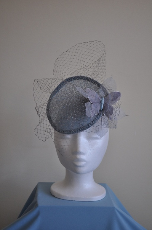 Powder blue sinamay fascinator with veiling
